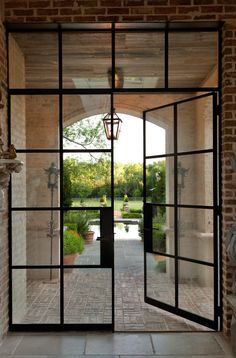Double French doors with transom. 8 lite doors and 4 lite transom - Portella Doors Portella doors also makes great shower enclosures with cold rolled steel. Also make great interior steel doors, sliding doors ( kitchen cabinets? Patio Doors, Entry Doors, Entrance, Garden Doors, Door Design, Exterior Design, Industrial Door, Vintage Industrial, Industrial Windows And Doors
