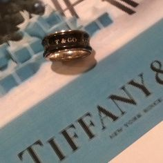 Tiffany & Co 1837 Midnight 925 & Titanium Ring Beautiful & Timeless Tiffany & Co 1837 Midnight Sterling Silver & Titanium Ring. In great condition. AUTHENTIC Thank You. Tiffany & Co. Jewelry Rings