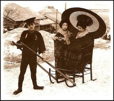GEISHA IN A SNOW TAXI -- JINRIKIZORI (Man Powered Sleigh) image showing such a unique scene of winter life in old Meiji Japan.