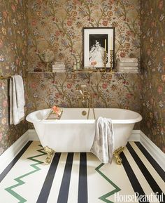 In this bold mashup in a Chicago bathroom decorated by Summer Thornton  — traditional and modern, florals and stripes — everything looks gorgeous together.    - HouseBeautiful.com