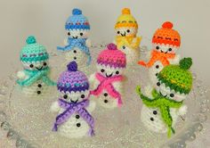 Keep cool and crochet these colorful snowmen! Pattern by Moji Moji Design. We recommend using Lion Brand Bonbons yarn.