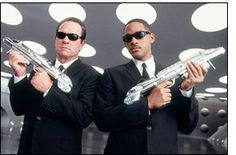 This #90s costume idea couldn't be easier!!  Black (or dark) suit and tie, sunglasses, and a funky weapon for fighting intergalactic criminals.  Men In Black: Agent Kay & Agent Jay http://www.90s411.com/90s-costumes-men-in-black.html