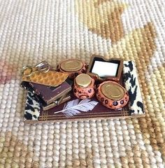 """Pat Tyler Artist Made Handcrafted Animal print trimmed desk blotter measures approximately 2""""Wide, and 1 1/4"""" Deep. All items in photo are included, and they are not glued down. Scale: 1 inch equals 1"""