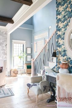 Our small traditional powder blue foyer with Fall decorating ideas with World Market! Fall foyer decorating ideas features .. #floor #woodfloor