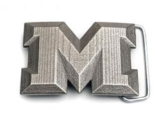 """A buckle for all named Michael, Melissa, Malcom, Monique, Manfred, Margaret, Marcy … The good thing, it works for Wiliam, Wendy, Walter … too. If you are a fan of the letter """"M"""", this one is your thing! Buckle, manufactured via Shapways 3D printing service."""