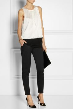 Vera Wang top, Arme De L'Amour bracelets, Etro ring, Stella McCartney ring and pants, Gianvito Rossi shoes, Jil Sander clutch.