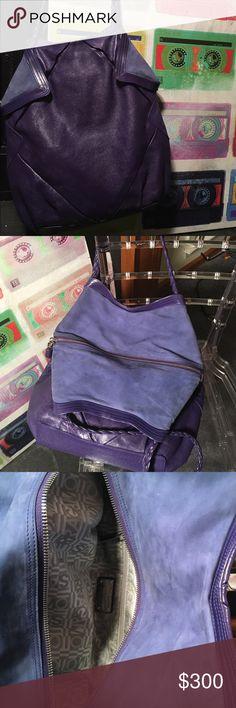 Salvatore Ferragamo origami purple bag Rare. Salvatore Ferragamo origami inspired  purple bag. Inside pocket. Lining  has Ferragamo classic logo. Braided handles. Salvatore Ferragamo Bags