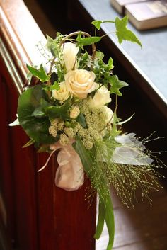 Maybe for the colums at the altar instead? White & Green Flowers  Church Pew Floral Arrangement  by Flower Design St Annes