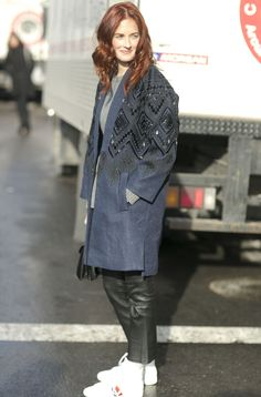 Taylor Tomasi Hill went luxe on top, sporty on bottom, adding high-tops to a beaded overcoat. Source: Tim Regas