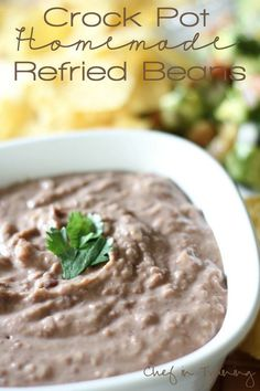 Crock Pot Homemade Refried Beans!  Once you try this easy recipe, you will NEVER go back to canned refried beans again!  These were so good, and didn't have that greasy lardy texture. Yum!