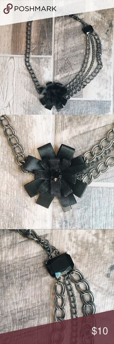 Black chain necklace with black bow detail This cute statement necklace is just what you need to spice up your outfit! It can be worn causally or for those date nights! Like brand new!  Taken care of and very cute and versatile! Jewelry Necklaces
