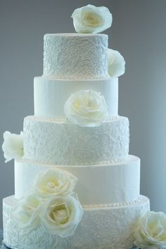 5 tier white wedding cake  flowers, lace