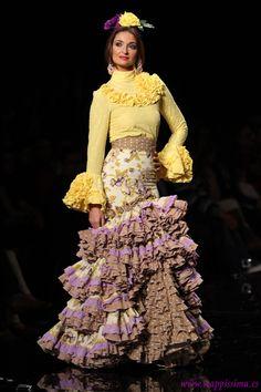Margarita Freire - SIMOF 2015  https://www.pinterest.com/thuyvyle1910/trajes-de-flamencas/?utm_campaign=activity&e_t=5951ec5a3ae54fba913849cb0ef89c8d&utm_medium=2003&utm_source=31&e_t_s=board_teaser
