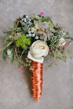modern bouquet wrapped in wire by @Susan Brown 7 Dezines in Blueberry Hill Events's tabletop. Photo by Josh McCullock Photo & Films.