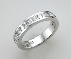 Princess and baguette diamond eternity ring by martin gotrel