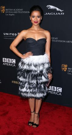 British actress Gugu Mbatha-Raw in a Burberry black tulle feather dress from the collection on the BAFTA Britannias red carpet Celebrity Red Carpet, Celebrity Style, Satin Dresses, Strapless Dress Formal, Burberry Dress, Burberry 2014, Raw Photo, Feather Dress, British Actresses