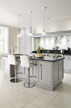 ...black counters, grey cabinets and white walls! (I think the first one. What do you think?)