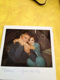 Richard Dean Anderson bites Teryl Rothery in a Stargate continuity Polaroid. Because, umm, he's RDA and he can! Jack O'Neill, Janet.