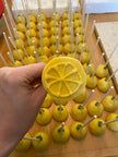 I made 140 lemon shaped cake pops for a bridal shower. : Baking