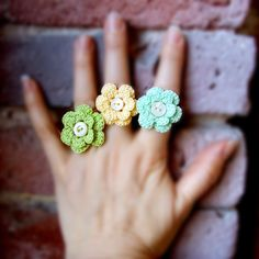 Crochet flower rings, so cute!  Would be quick and easy to make one.  Hers are especially cute.