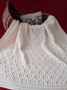 Knitting Patterns for Irish Lullaby Blanket - An interlaced Celtic heart is knit. Knitting Patterns for Irish Lullaby Blanket - An interlaced Celtic heart is knit flat to fors the centrepiece of this bl. Cable Knitting Patterns, Knitting Stitches, Free Knitting, Baby Knitting, Baby Blanket Knitting Patterns, Knitting Needles, Knitted Afghans, Knitted Baby Blankets, Baby Blanket Crochet
