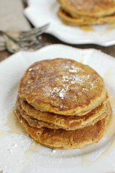 Pumpkin Pie Pancakes soft, flavorful pancakes that use whole wheat flour and yogurt to create a healthier twist on your favorite fall dessert. Drizzle maple syrup and a sprinkle of powdered sugar on them and you are ready to enjoy. // A Cedar Spoon