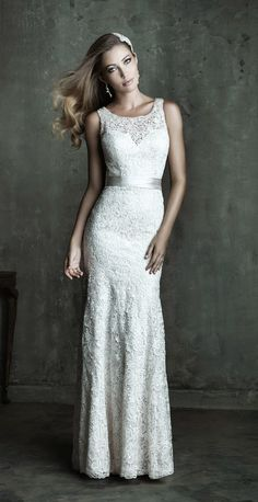 Allure Couture Spring 2014 Bridal Collection - Style C284. Soft and sweet, this sleeveless lace gown gives a peep of skin through a demure lace overlay, while the dress is accented simply with a satin waistband.