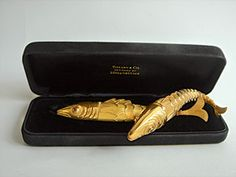Lighters in heads of fish of 18k gold, c.1955, designed by Jean Schlumberger for Tiffany & Co.