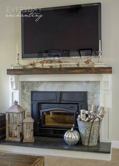 Learn how to cover your brick fireplace to transform it from dated to modern farmhouse style with stone, painted wood, and a solid rustic pine mantel. Brick Fireplace, Fireplace Hearth Decor, Autumn Home, Lantern Decor Living, Fireplace Hearth, Fireplace Design, Living Room Decor, Lanterns Decor, Fall Living Room