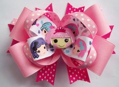 This Little LaLa Girls Bow. The hair bow measures almost 5 1/2 inches across and is made on a partially lined hair clip. This bow is so cute. The bow looks great worn alone but would also look great attached to a headband or hat for an infant, baby or toddler. $8.00