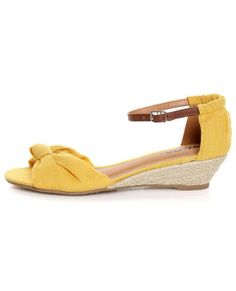 A twist on the classic knot wedge heel in a summery, sunny shade of yellow.