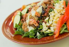 Shrimp Cobb Salad with Avocado Dressing Serves 4 DO-AHEAD TIP: Prepare shrimp, bacon and eggs INGREDIENTS: 3 cups arugula 2 cups chopped kale, ribs removed 1 medium cucumber, chopped 1 medium peach, pitted and cubed 16 large shrimp, peeled and deveined, cooked and chilled 5 slices bacon, cooked and chopped 4 eggs, hard-boiled and sliced…