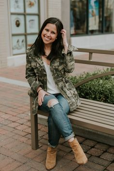 Monica of 45 Fairmount dressing for spring with a camo jacket and dark denim.