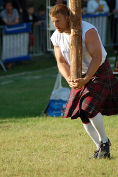 """Tossing the Caber, a traditional Scottish athletic event in which competitors toss a large tapered pole called a """"caber"""". It is normally practised at the Scottish Highland Games. In Scotland the caber is usually made from a Larch tree and is typically 19 feet 6 inches (5.94 m) tall and weighs 175 pounds (79 kg). The term 'caber' derives from the Gaelic word """"cabar"""" or """"kaber"""" which refers to a wooden beam The person tossing the caber is called a """"tosser"""" or a """"thrower""""."""