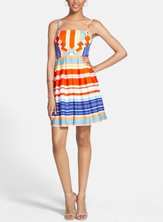Gorgeous! Adore the bright bold stripes on this fit  flare dress.