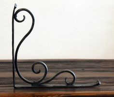 Forged Metal Shelf Bracket - Hammered Scroll Design - Style 02 by ArtisansoftheAnvil on Etsy https://www.etsy.com/listing/53051215/forged-metal-shelf-bracket-hammered