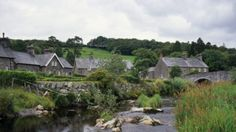 Village of Ysbyty Ifan on River Conwy in the Wybrnant Valley has houses of old Welsh stone. There is an arched bridge over the river and rocks and reeds in the river bed. © NTPL/Ian Shaw  http://www.nationaltrust.org.uk/visit/local-to-you/wales/things-to-see-and-do/snowdonia/