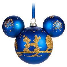 Relive happy memories of your holiday visit to Walt Disney World while gazing at this souvenir Mickey Mouse icon glass ornament with royal blue satin finish and golden pixie dust frosting of favorite park icons and characters. Disney Christmas Ornaments, Mickey Christmas, Christmas Gifts For Women, Outdoor Christmas Decorations, Christmas Bulbs, Christmas Ideas, Blue Christmas, Christmas Crafts, Peanuts Christmas