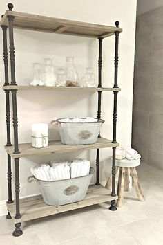 This rustic wood shelf and small accent stool from HomeGoods were the perfect way to add style and storage space to our master bathroom! {Sponsored Pin}