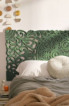 Finding a nice headboard can be tricky. This one will add plenty of interest to your clean white room without feeling like it's taking over. #carvedheadboard #greenheadboard #patternedheadboard