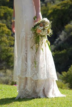 love the lace popping off the dress , and love the rustic bouquet