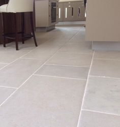 Beige stone tiles made from Luberon Limestone were used for this kitchen floor. Fitted in running lengths for a simple, understated effect. http://www.naturalstoneconsulting.co.uk/antique-limestone-luberon-limestone-flooring