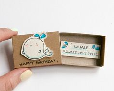"This listing is for one matchbox. This is a great alternative to a Birthday card. Surprise your loved ones with a cute private message hidden in these beautifully decorated matchboxes!  Each item is hand made from a real matchbox. The designs are hand drawn, printed on paper and then hand assembled to give each individual matchbox that special personalized touch. Weve found that these matchboxes are the perfect way to brighten someones day :)  Dimensions: 2 1/16 (length) x 1 3/8"" (w..."