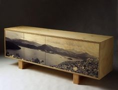 There are a lot of creative ways one could apply photo transfers to furniture...this piece is inspiring.