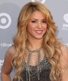Shakira Hairstyle - Long Wavy Casual - Medium Blonde. Click on the image to try on this hairstyle and view styling steps!