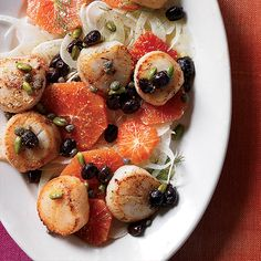 Scallops with Blood Orange, Fennel and Pistachios | This easy and delicious salad features sweet, plump seared sea scallops on a Sicilian-style salad with briny green olives and fried capers.