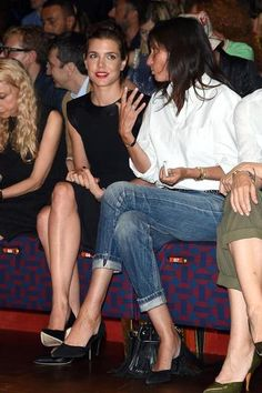 Completely simple, but totally chic, a great fail-safe outfit is cuffed blue jeans, a tucked-in white-button down, and black stilettos.