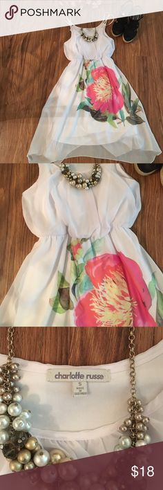 White dress with flower Great condition! Only worn once for my graduation. Has slip underneath. There's a little bit of stiching on the bottom of one side, but it's barely noticeable, as shown in the last picture. Ask any questions! Dresses