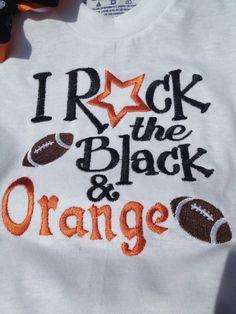 I rock the black and orange' onesie, black and orange glittery tutu, and matching hair bow