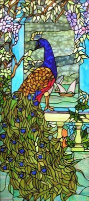 Art nouveau stained glass peacock. Just think of all the beautiful colors in your room as the sun shines through! :-)